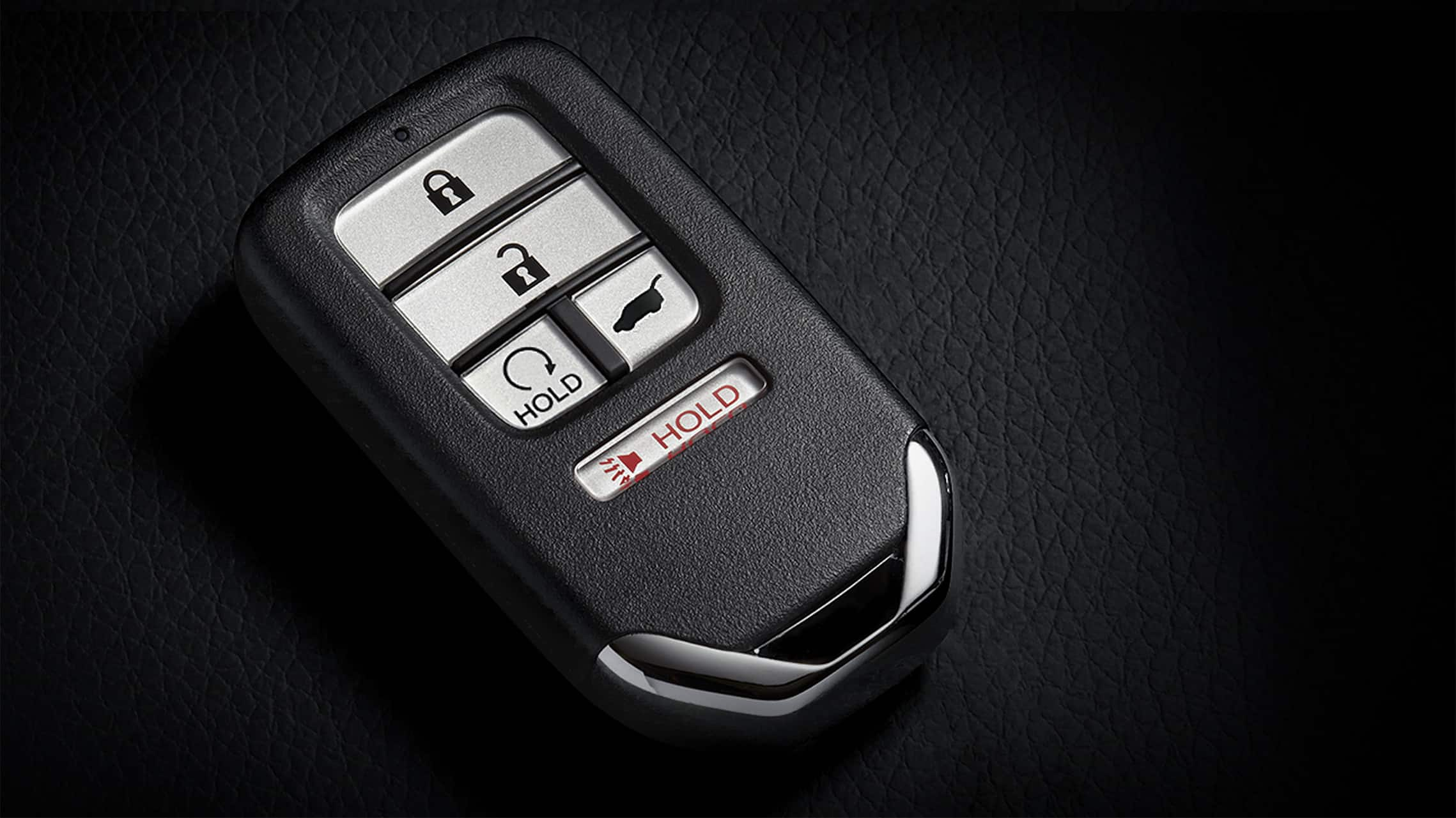 Key fob with remote engine start button detail for the 2021 Honda Civic Sport Touring Hatchback.