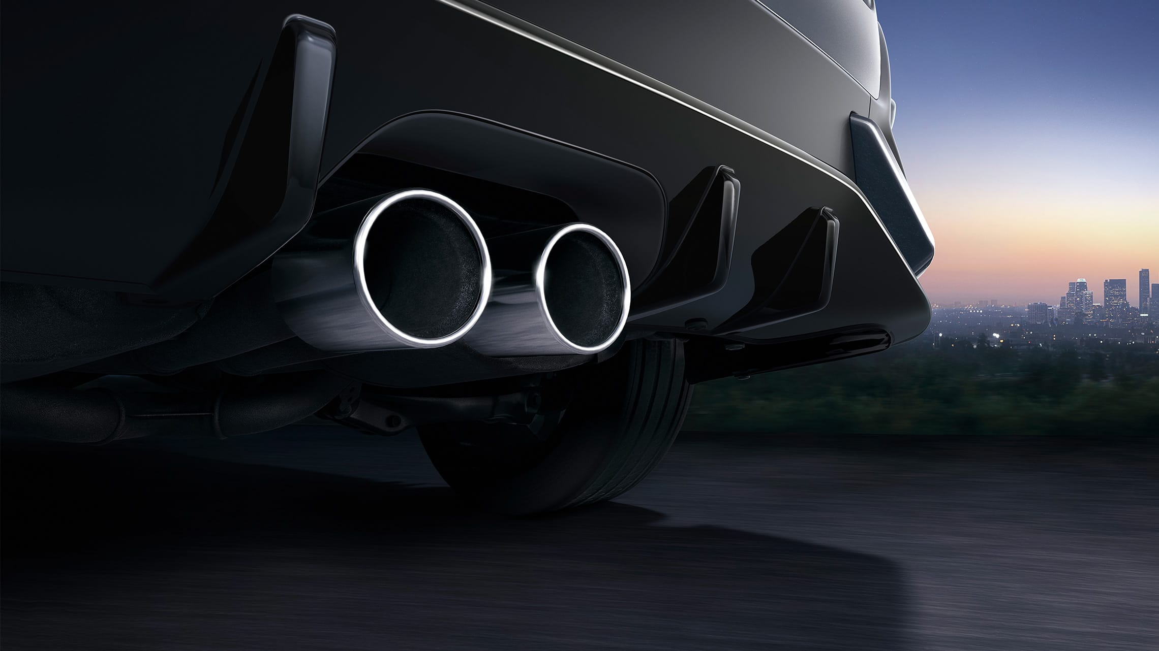 Center-mounted dual-outlet exhaust detail on the 2021 Honda Civic Sport Touring Hatchback in Sonic Gray Pearl.