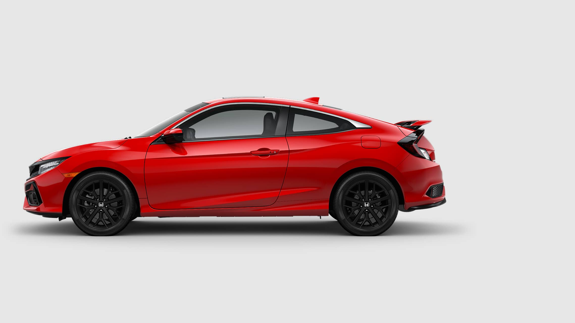 Driver's side view of 2020 Honda Civic Si Coupe in Rallye Red.