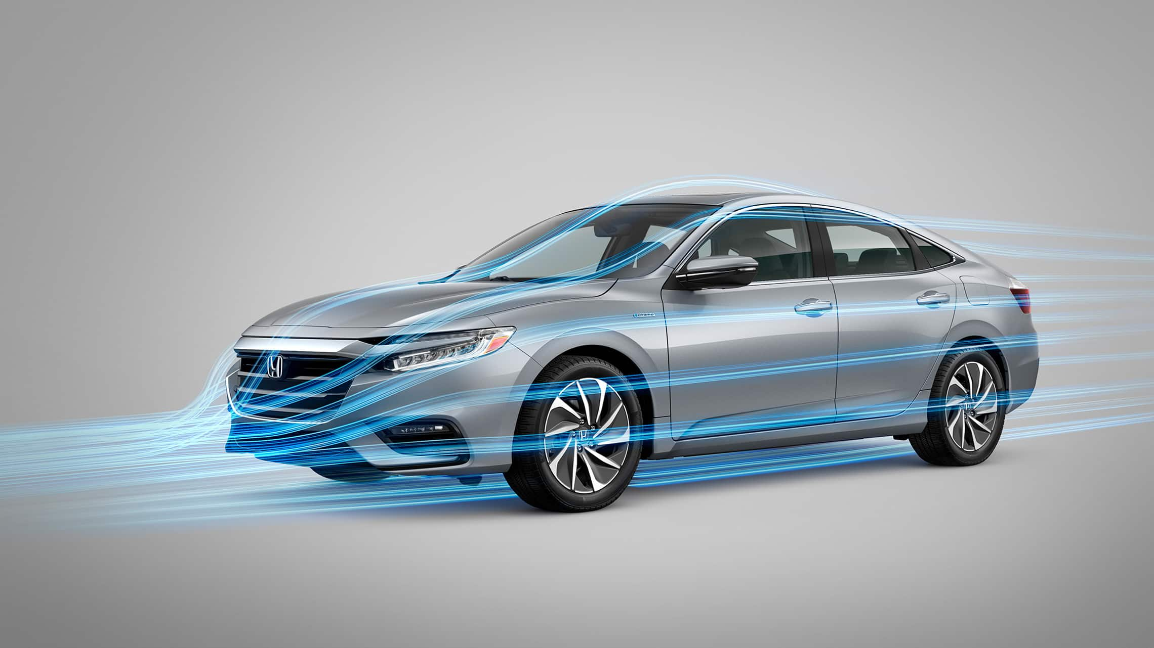 Front driver-side view of 2021 Honda Insight Touring in Lunar Silver Metallic with slipstream graphic overlay.