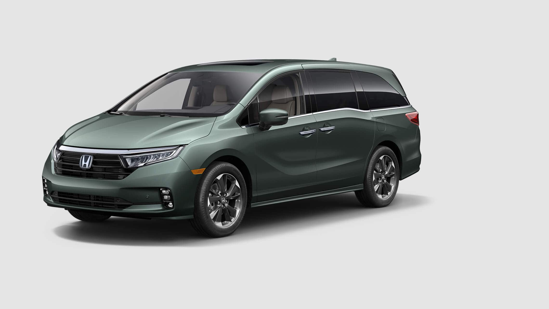 Front driver-side view of the 2021 Honda Odyssey Elite in Forest Mist Metallic.