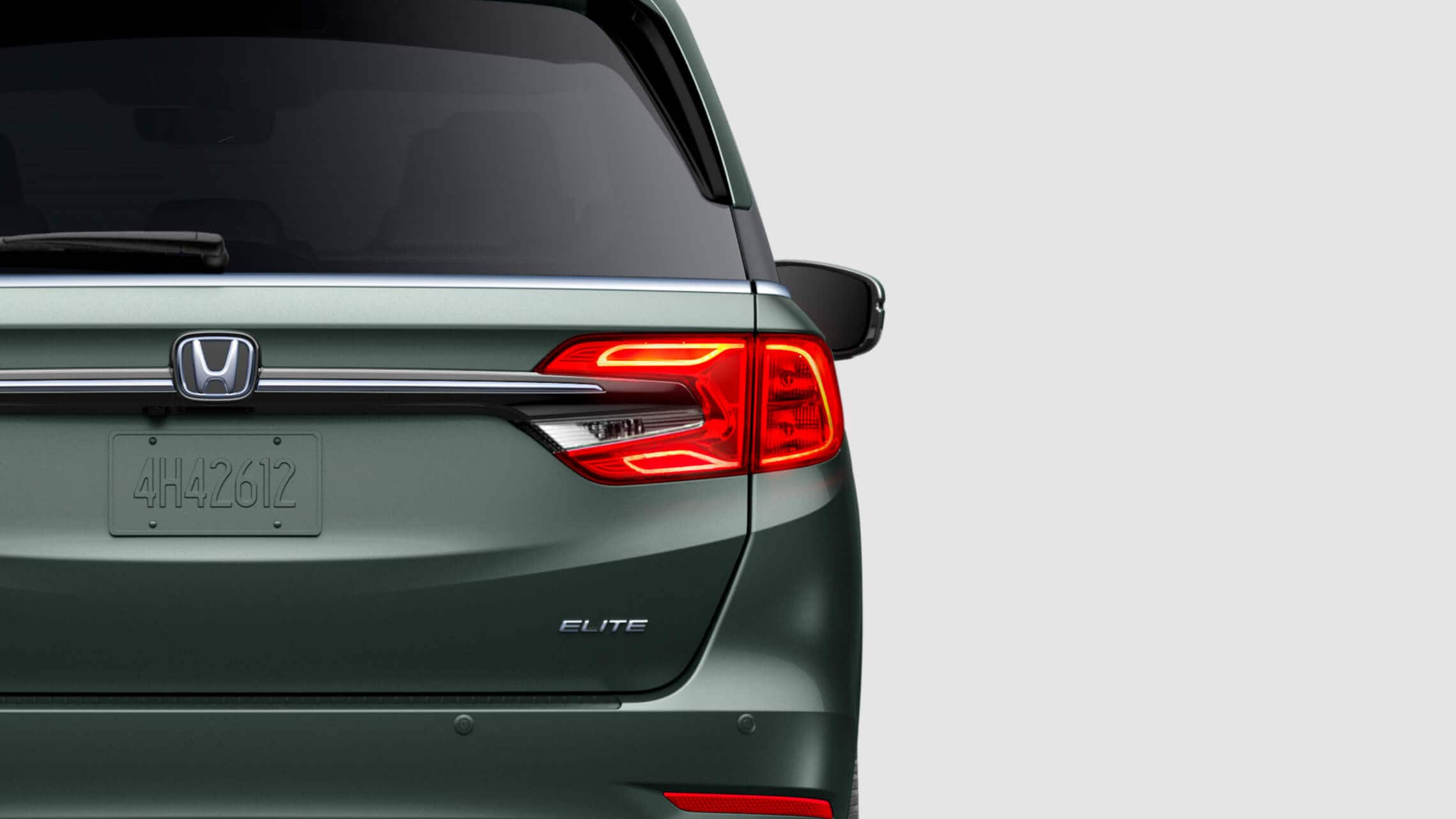Rear close-up view of driver-side taillight on the 2021 Honda Odyssey Elite in Forest Mist Metallic.