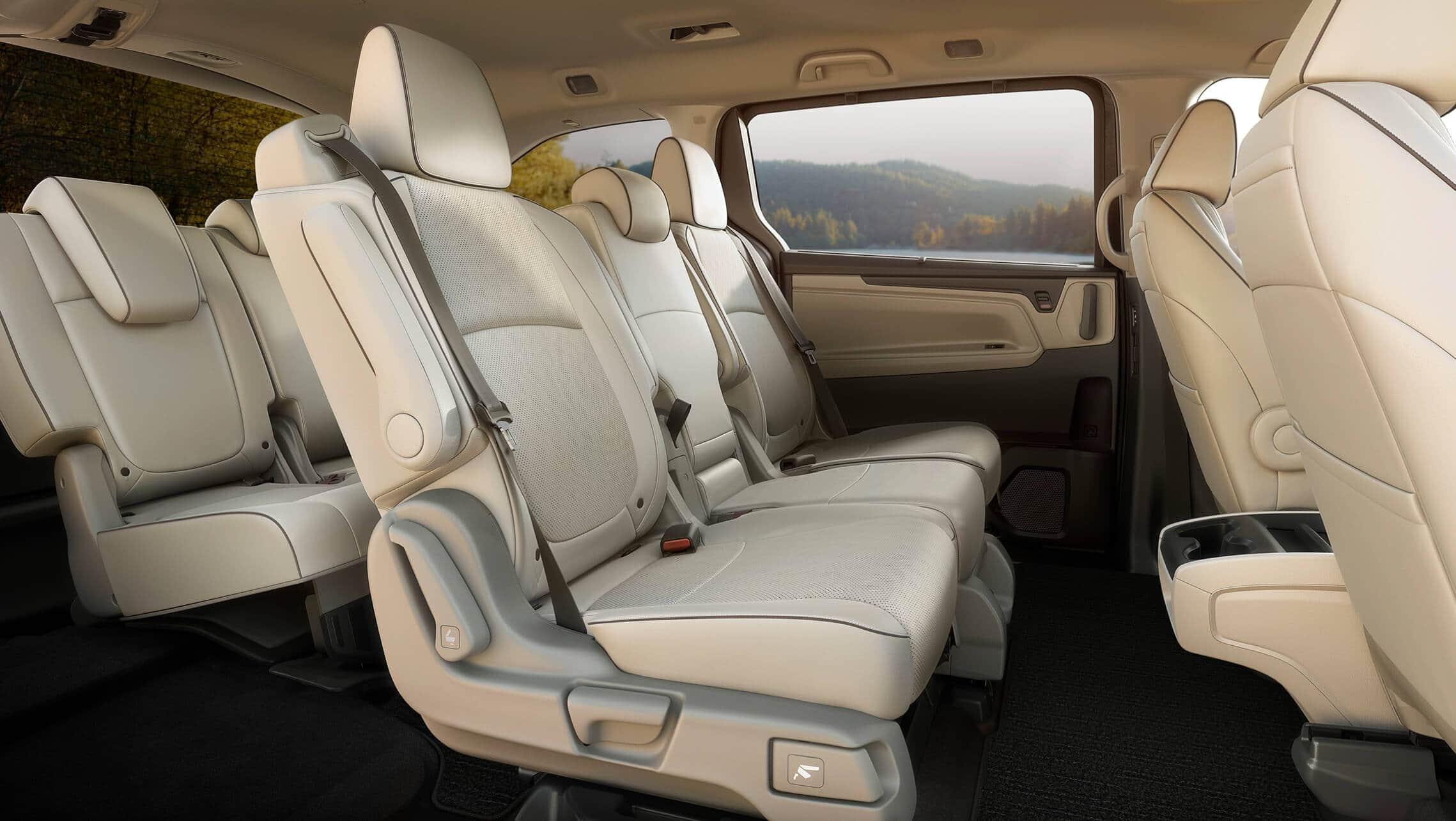 Interior passenger-side profile view of rear seats in the 2021 Honda Odyssey Elite with Beige Leather.