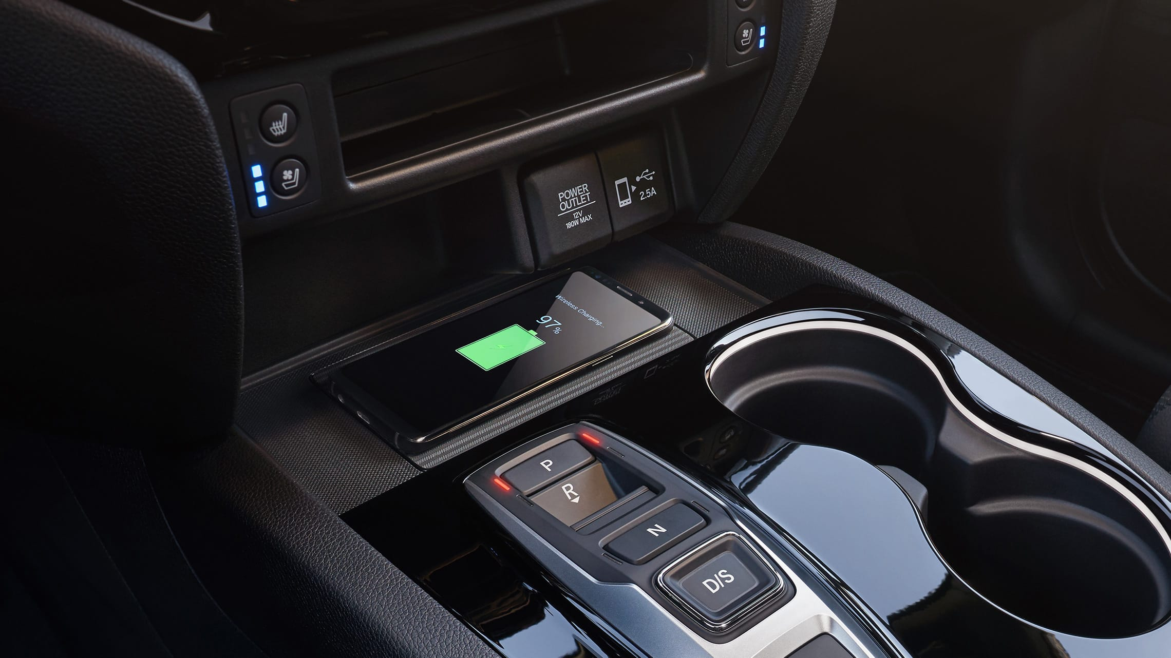 Wireless phone charger detail on the 2021 Honda Passport Elite.